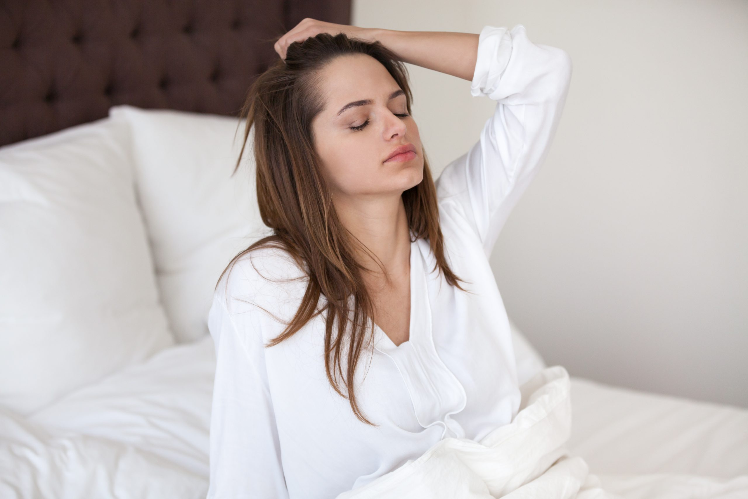 Waking Up with a Headache? 7 Possible Causes & Fixes